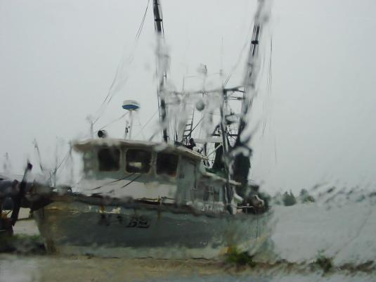 Fishing boat in the rain.